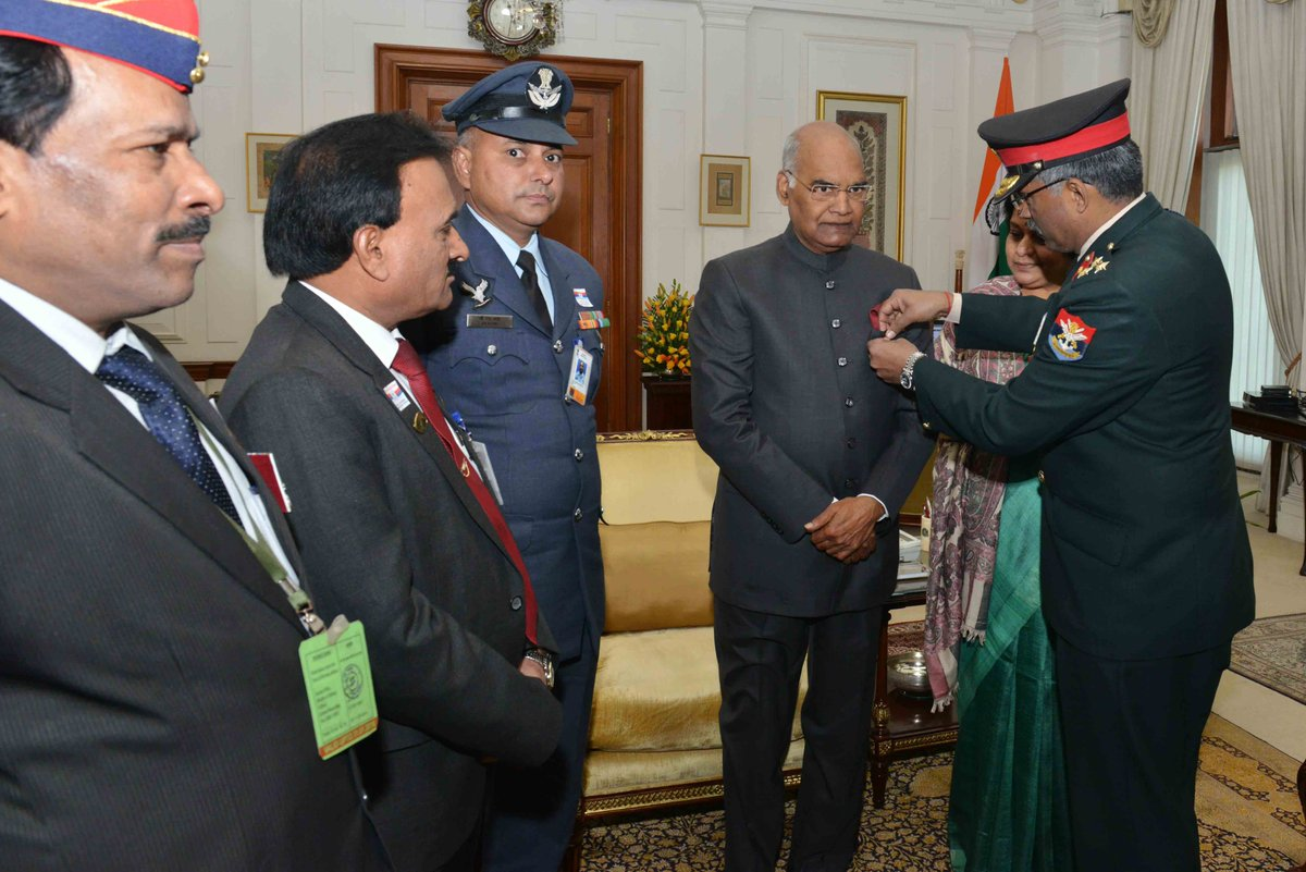 Secretary, Kendriya Sainik Board, pinning a lapel on  Hon'ble President of India ,  Shri Ram Nath Kovind on the occasion of the Armed Forces Flag Day, in New Delhi on December 07, 2017.