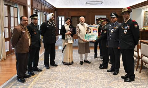 Hon'ble PM unveiling the commemorative material on the occasion of the AFFD, in New Delhi on 07.12. 2018.